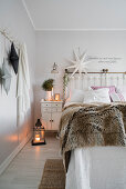Double bed and Christmas decorations in bright bedroom