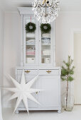 Christmas decorations on white dresser