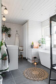 Houseplants in cosy grey-and-white bathroom