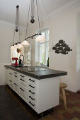 Island counter below pendant lamps