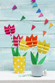Tulips made from striped drinking straws and craft paper