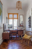 Vintage furniture in study of Parisian period building