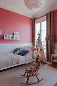 Pink-and-white two-tone walls in child's bedroom