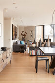 Modern, open-plan interior in earthy shades
