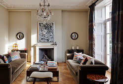 Stucco ceiling and open fireplace in classic living room of period building