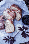 Slices of nut cake and blackberries