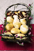 Basket of bread rolls decorated with fragrant flowers