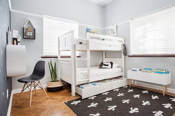 White bunk beds with storage drawer below in children's bedroom