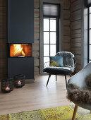 Roaring fire in modern fireplace in log cabin
