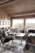 Grey accessories and wood panelling in chalet living room