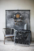 Dreamcatcher and painted wall hanging above table