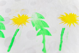Fabric printed with dandelion motif (DIY foam rubber stamp)
