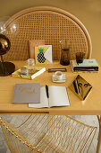 Writing utensils, books and cup of tea on table