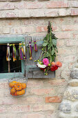 Garland of fabric tassels, dahlias and basket of pumpkins