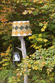 Hand-crafted standard lamp made from weathered branch and knitted lampshade