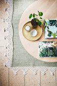 Pilea and books on a round wooden coffee table