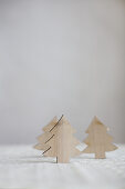 Three wooden Christmas trees