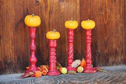 Small pumpkins on candlesticks