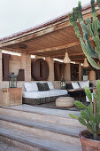 View onto roofed terrace with elegant furnishings
