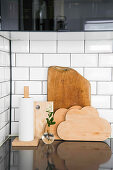 Cloud-shaped chopping boards and kitchen roll on simple holdeer