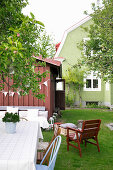 Seating area in Scandinavian summer garden of green house