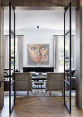 Glance into the elegant living room with artwork on the wall