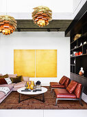 Upholstered sofa, leather armchair and coffee table in the living room