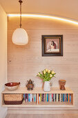 Floating sideboard mounted on board wall below arch with indirect lighting