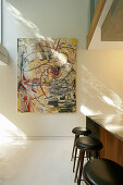 Large abstract painting on sunny wall