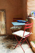 Metal folding chair and table on stone floor