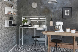Rustic wooden table and sink on metal stand in black-and-white kitchen with various patterns