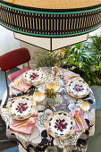 Colourful tablecloth and crockery on bistro table