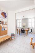Open doorway leading into dining room with Scandinavian designer chairs
