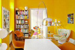 Classic chairs in dining room with yellow walls