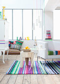 White living room with brightly striped accessories