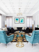 Black upholstered sofas and turquoise armchairs with velvet upholstery in a luxurious living room