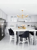 Elegant kitchen with large dining table and designer chairs
