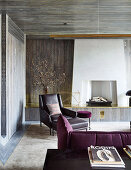 Fireplace room with leather armchair and dark red upholstered sofa