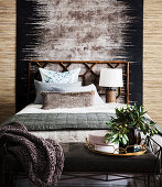 Carpet behind the bed in the bedroom in earth tones