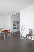 Old wooden chair in dining room with flexible wall and fitted cupboards