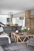 Grey sofa and large coffee table in cosy living room