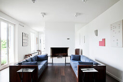 Two sofas facing one another in minimalist living room
