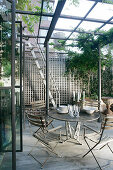 Garden furniture under pergola on roof terrace in New York