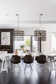 Modern black and white dining room with table on trestles