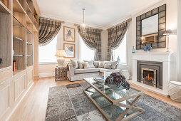 Fireplace in elegant living room in shades of grey
