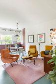 Retro armchair in open-plan interior in warm shades