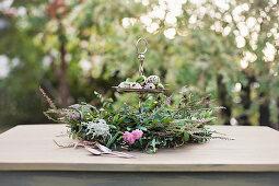 Luxuriant wreath around quail eggs on cake stand