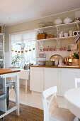 Christmas decorations in white, rustic kitchen