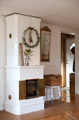 White tiled stove with Christmas decorations