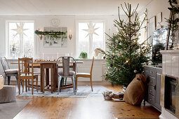 Christmas decorations and decorated tree in rustic living room